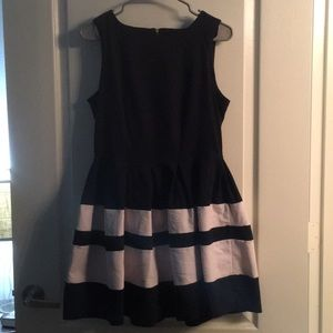 Navy blue dress with white stripe detail